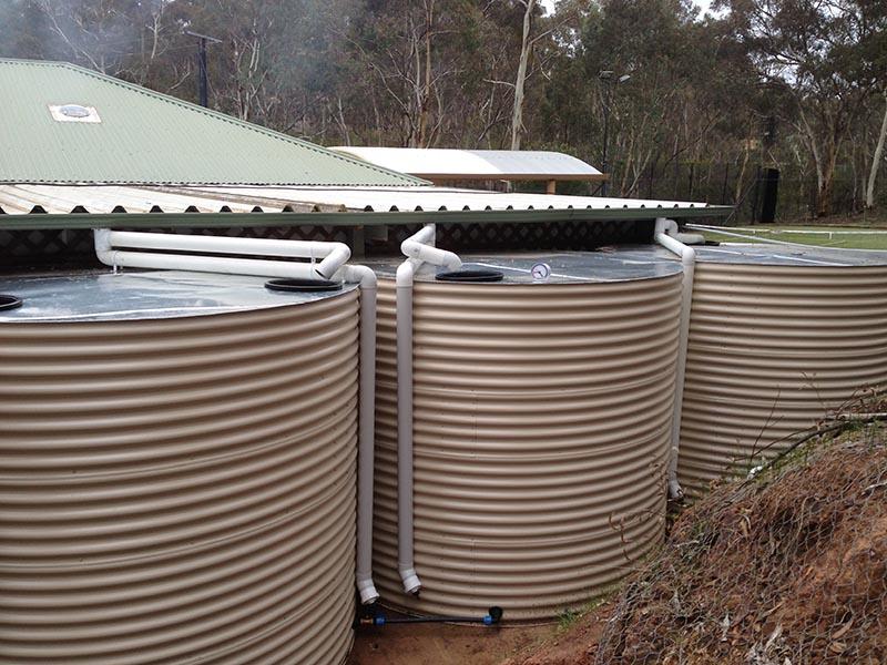 bank of rainwater tanks at rear of property