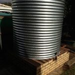 galvanised steel rainwater tank on existing base