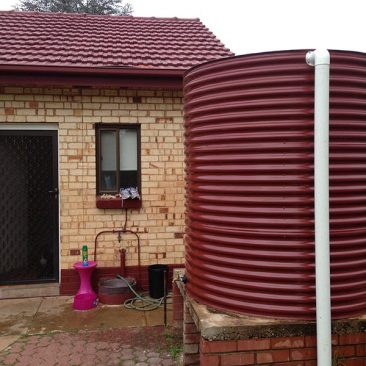 Aquaplate tanks Manor Red to match the roof of house