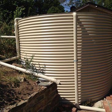 cream aquaplate tank in existing garden area
