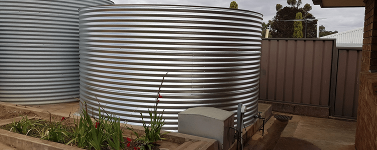 two galvanised tanks side by side installed at house in Greenock SA
