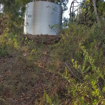 galvanised steel tank on hill in Forest Range SA