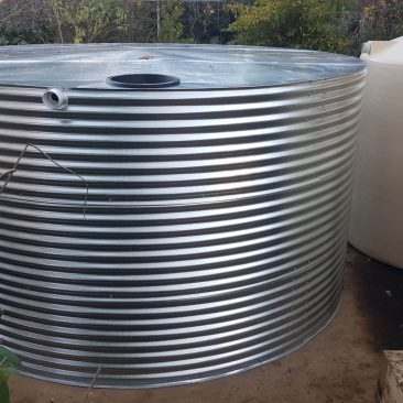 Glavanised Steel Rainwater Tank next to Poly tanks at Carey Gully SA