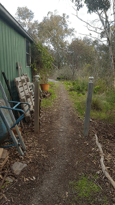 Path beside green shed showing access area to position rainwater tank