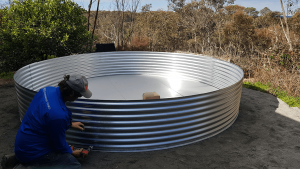 Base rung for rainwater tank with Steve putting it together