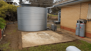 concrete base next to existing rainwater tank