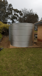 New rainwater tank next to old tank on existing concrete base