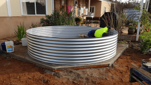 Base rung for rainwater tank with Steve inside working