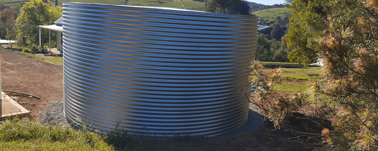 Galvanised Steel rainwater tank on hill at clarendon property