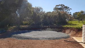 Gravel base for tank