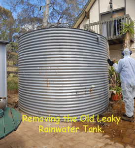 old leaky rainwater tank ready to be taken away