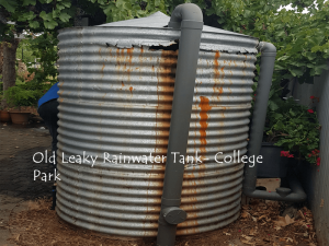 old leaking galvanised iron rainwater tank with rust marks from leaking rainwater