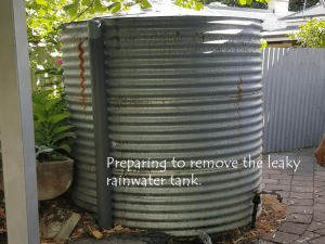 preparing to move the leaky rainwater tank